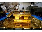 Gold rises as Dollar Weakens to Near Three-Year Lows