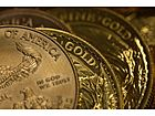 Gold Rises as Dollar Weakens Ahead of U.S. Fed Meeting
