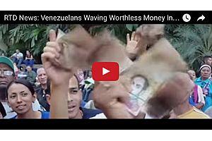 Venezuelans Waving Worthless Money In the Air