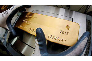 Gold Heads for Weekly Gain as Dollar Slips, Stocks Try for Recovery