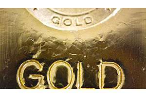 Gold secures weekly gain as dollar slips, stocks trade Down