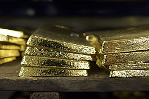 Gold Gains in Choppy Trade As Investors Digest Fed Strategy